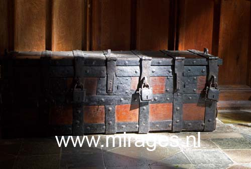 Big wooden chest with iron locks in Winchester cathedral. England, UK.
